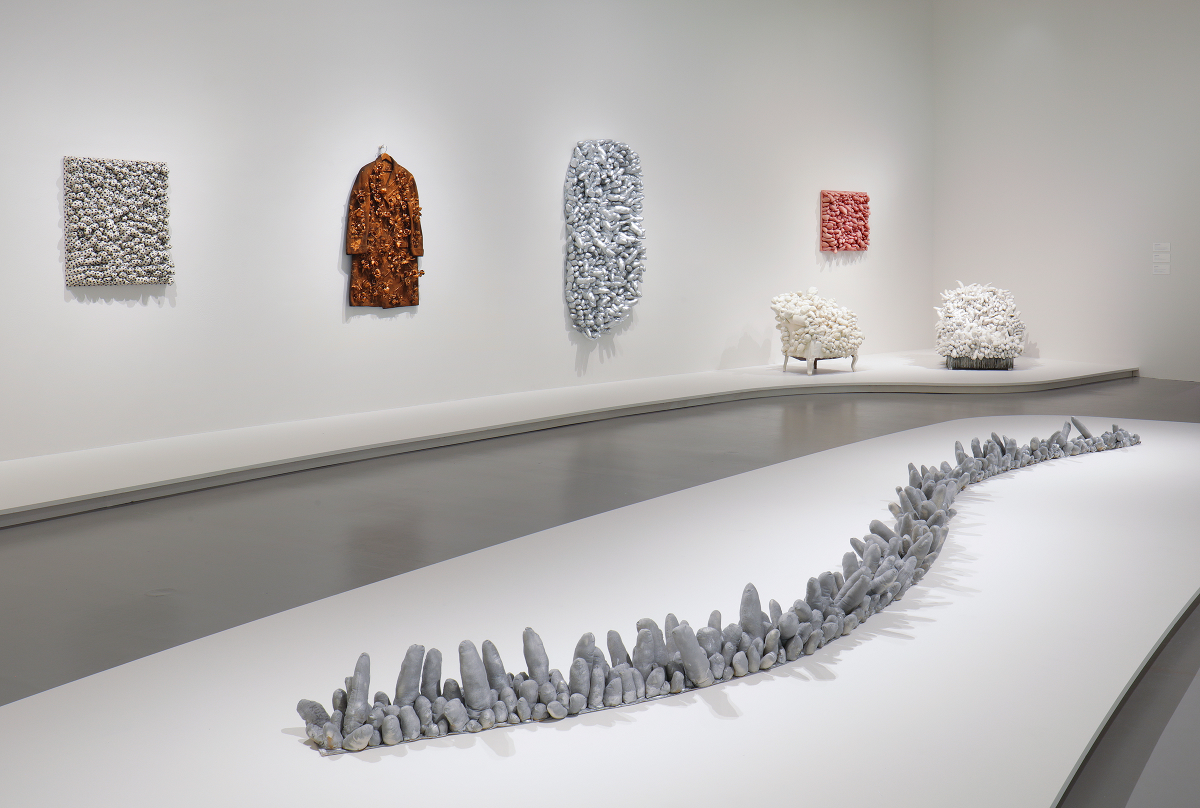 Left to right: Blue Spots, 1965; Flowers – Overcoat, 1964; A Snake, 1974; Ennui, 1976; Accumulation, 1962-64; Red Stripes, 1965; Arm Chair, 1963