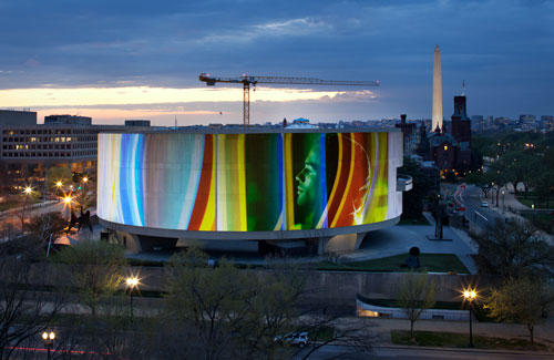Capture of Doug Aitken SONG 1 projected onto the Hirshhorn Museum building