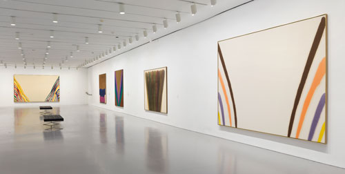 Installation view of Gravity's Edge at the Hirshhorn Museum and Sculpture Garden, Smithsonian Institution, Washington DC, 2014. Left to right: works by Morris Louis, Helen Frankenthaler, Kenneth Noland, Morris Louis, and Morris Louis. Photo: Cathy Carver