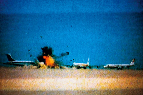 Three hijacked jets on desert airstrip, Amman, Jordan, September 12, 1970. Still from Johan Grimonprez's Dial H-I-S-T-O-R-Y, 1997. Courtesy of zap-o-matik & Sean Kelly, New York