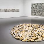 Installation view of At the Hub of Things: New Views of the Collection at the Hirshhorn Museum and Sculpture Garden, Smithsonian Institution, Washington DC, 2014. Left to right: Jan Dibbets, Tide, 1969; Richard Long, Norfolk Flint Circle, 1992; Brice Marden, Cold Mountain 2, 1989–91. Photo: Cathy Carver
