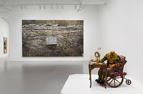 Installation view of At the Hub of Things: New Views of the Collection at the Hirshhorn Museum and Sculpture Garden, 2014. Left to right: Robert Rauschenberg, Dam, 1959; Anselm Kiefer, The Book, 1979-85; Yinka Shonibare, The Age of Enlightenment—Antoine Lavoisier, 2008. Photo: Cathy Carver