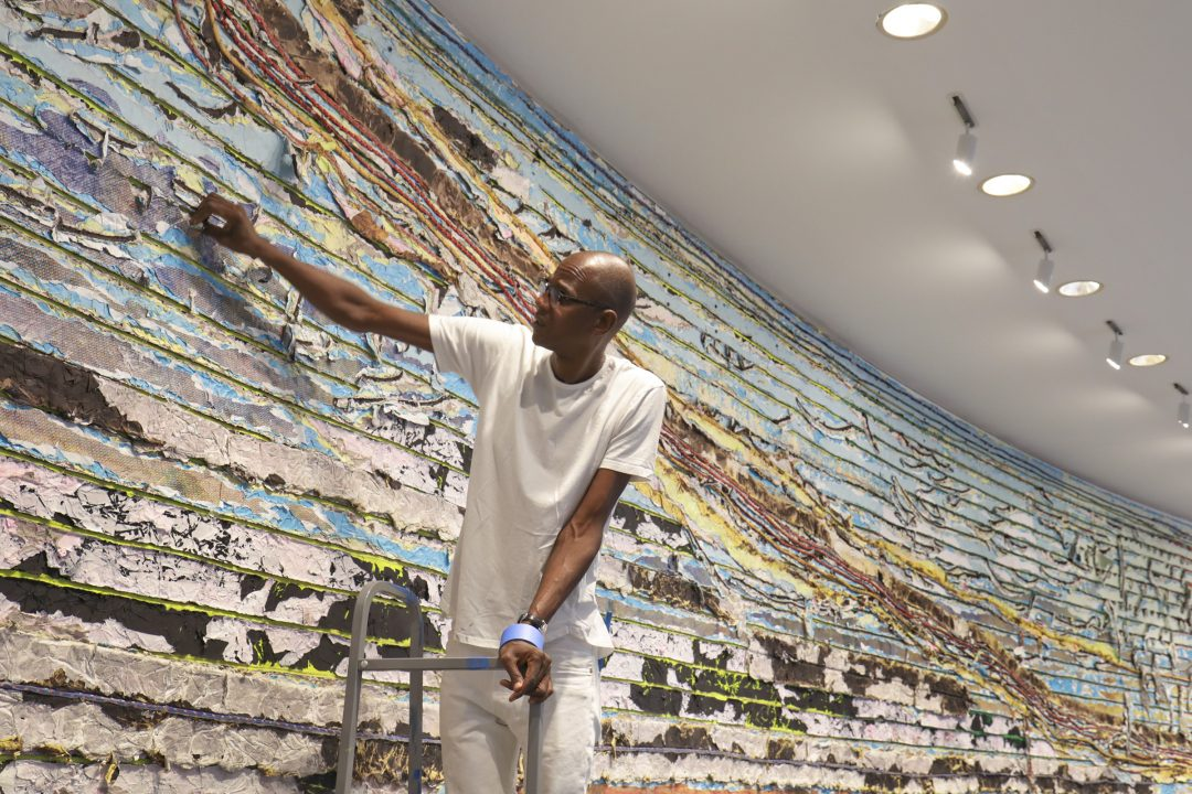 Mark Bradford at the Hirshhorn Museum and Sculpture Garden with details of Pickett's Charge, 2017. Courtesy of the artist and Hauser & Wirth. Photo: Cathy Carver.