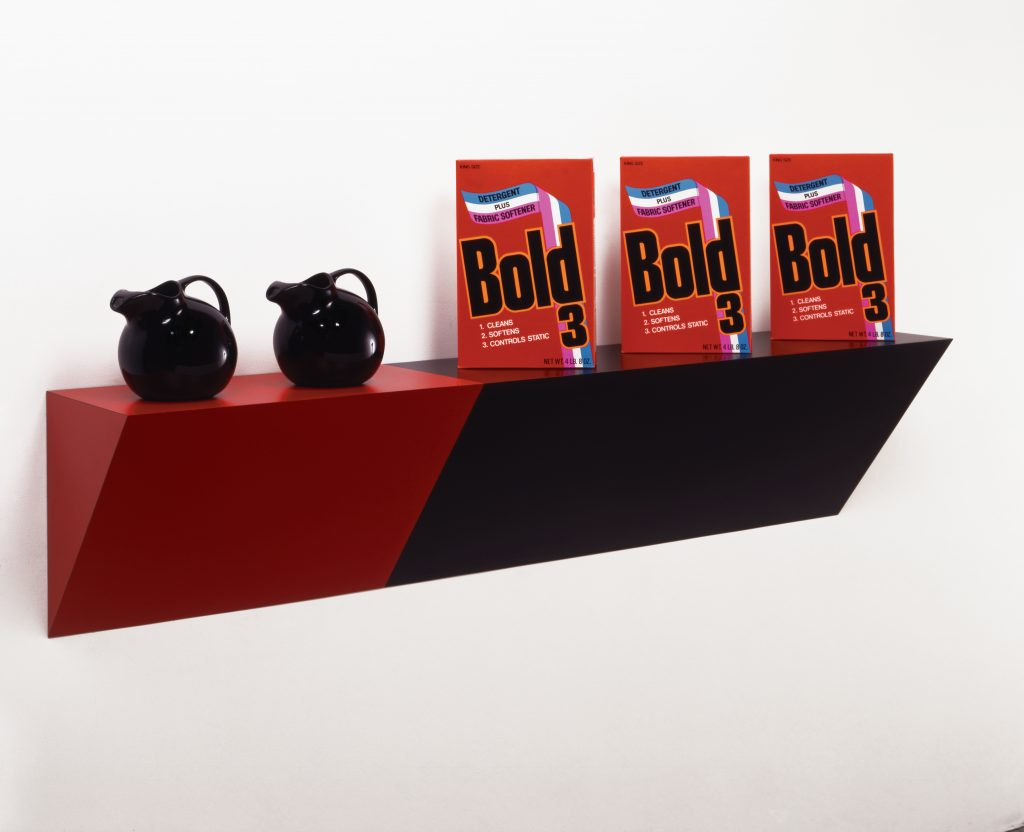 Haim Steinbach, Supremely black, 1985; plastic laminated wood shelf, 2 ceramic pitchers, 3 cardboard detergent boxes; 29 x 66 x 13 in. Private Collection; courtesy the artist and Tanya Bonakdar, New York.