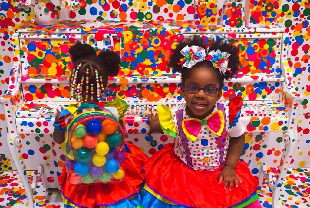 "Aries and Aubrie in Yayoi Kusama's ""The Obliteration Room"" at the Hirshhorn Museum and Sculpture Garden, 2017. Photo by Penelope Fly."