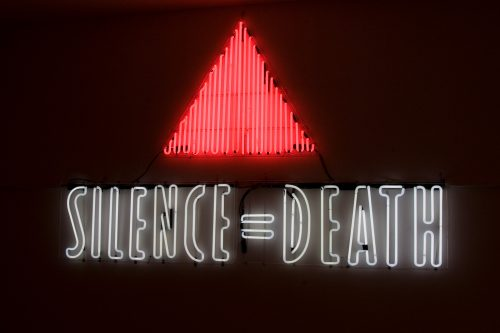 ACT UP (Gran Fury), SILENCE = DEATH, 1987. Neon sign, two colors; 48 x 79 in (121.92 x 200.66 cm). Courtesy New Museum, New York. William Olander Memorial Fund
