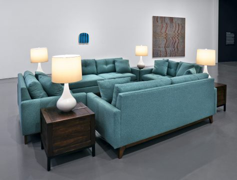 Installation view of Brand New: Art and Commodity in the 1980s at the Hirshhorn Museum and Sculpture Garden, 2018. Left to right: Ken Lum, Untitled Furniture Sculpture, 1980–; Sherrie Levine, Chair Seat: 5, 1986; Philip Taaffe, Undercurrent, 1984. Photo: Cathy Carver.