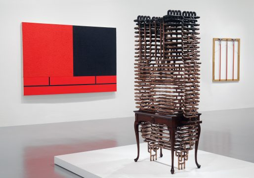 Installation view of Brand New: Art and Commodity in the 1980s at the Hirshhorn Museum and Sculpture Garden, 2018. Left to right: Peter Halley, Glowing and Burnt-Out Cells with Conduit, 1981; Joel Otterson, Devil/Jesus, 1986; B. Wurtz, Three Orange Mops, 1986. Photo: Cathy Carver.