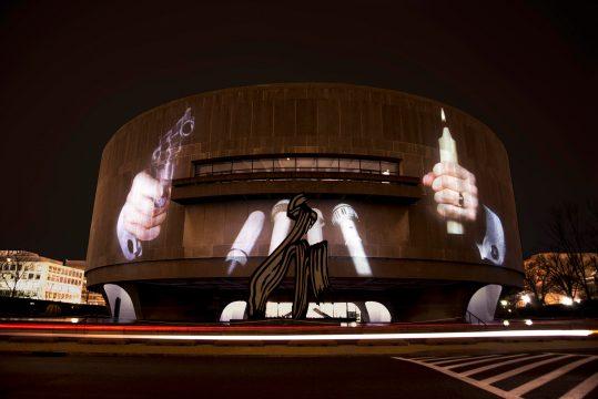 Krzysztof Wodiczko, Hirshhorn Museum, Washington, DC, 1988. Public projection at the Hirshhorn Museum, Washington, DC, February 13-15, 2018. Courtesy the artist and Galerie Lelong, New York. Photo: Joshua Jest
