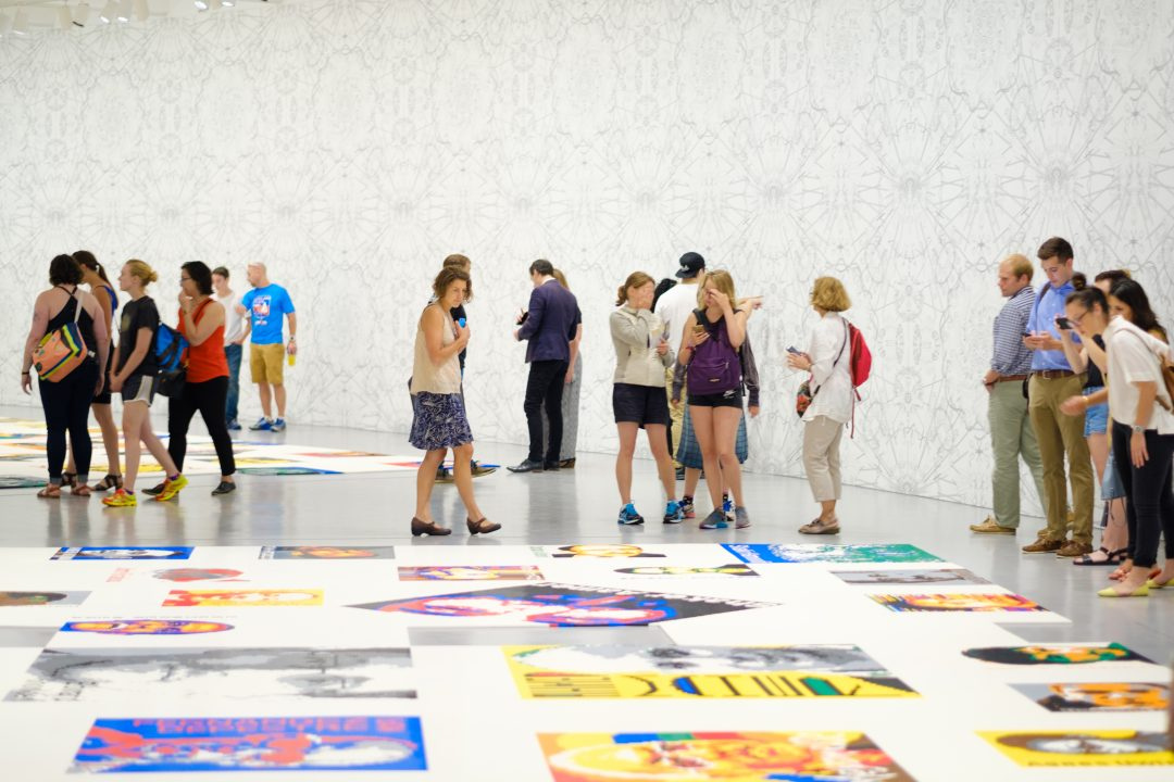 Visitors in gallery, Ai Weiwei Trace at Hirshhorn