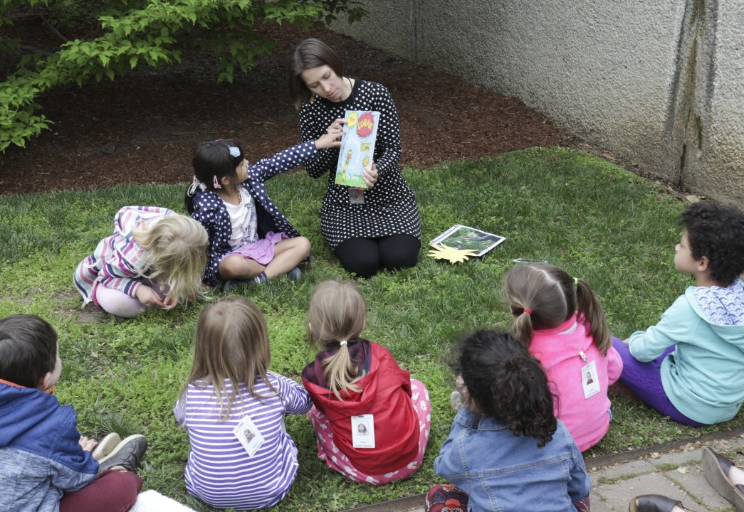 Children participating in STORYTIME in the Hirshhorn garden