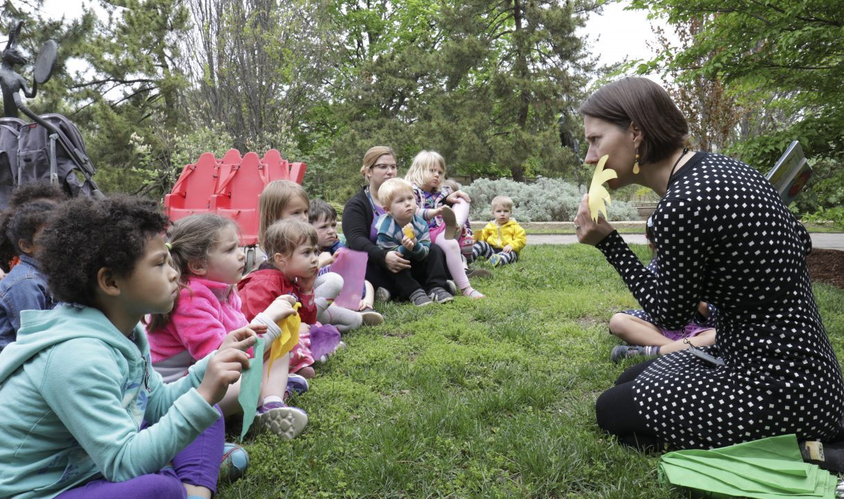 Children in sculpture garden participating in STORYTIME