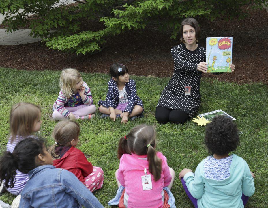 Children in sculpture garden participating in STORYTIME