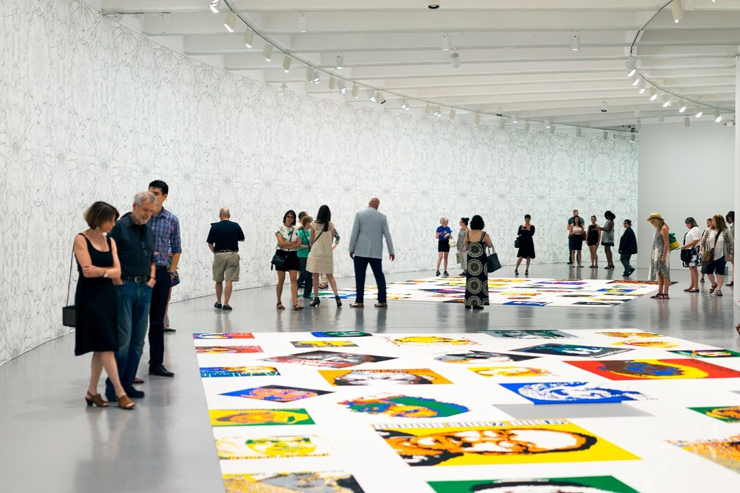 Visitors in gallery Ai Weiwei Trace at Hirshhorn
