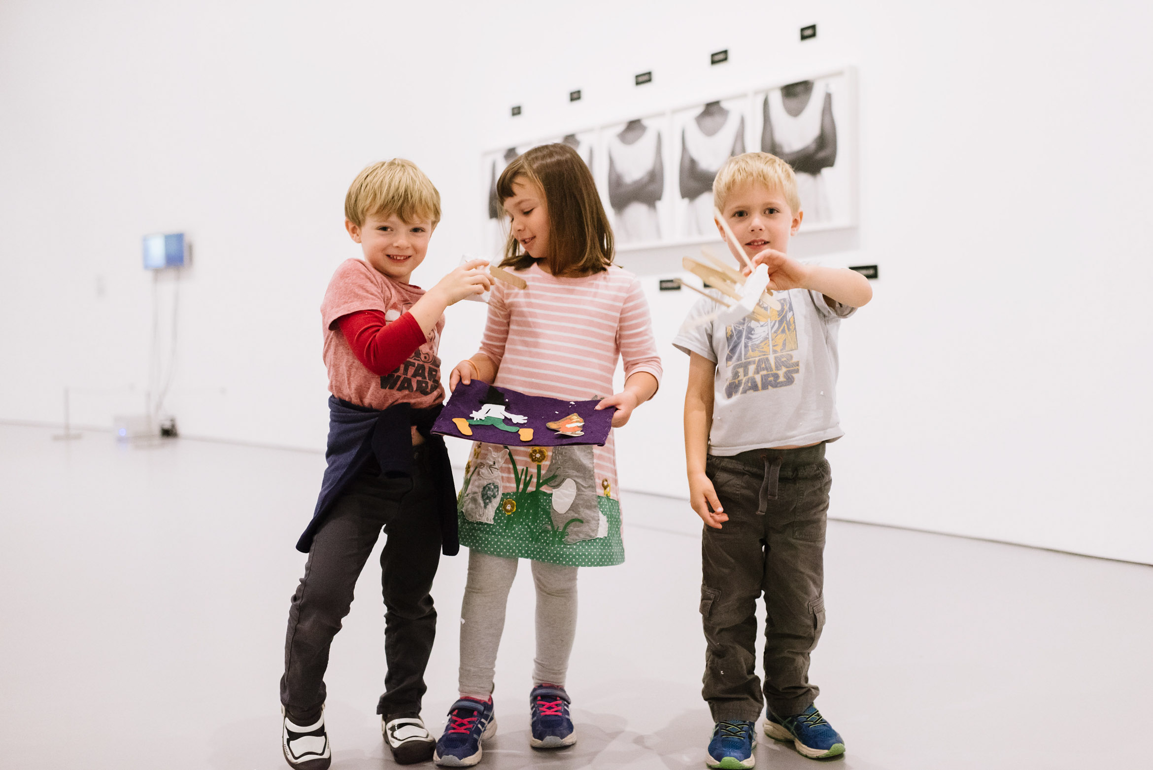 Children in gallery with craft project
