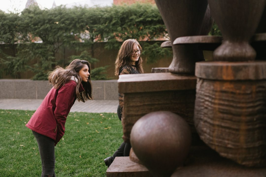 Visitors with a sculpture at the Hirshhorn
