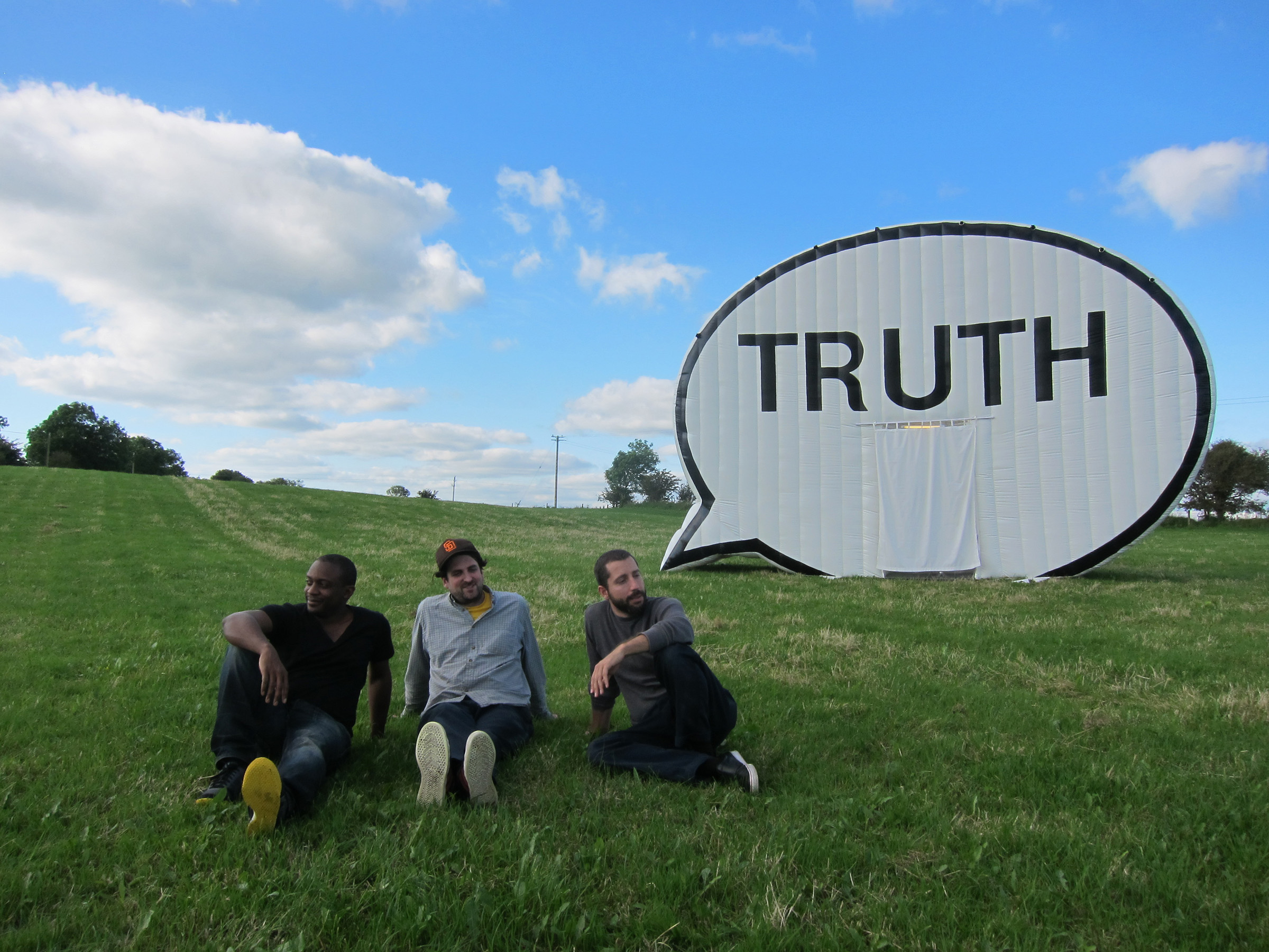 "Ryan Alexiev, Hank Willis Thomas and Jim Ricks with ""The Truth Booth"" in Ireland. Photo courtesy Cause Collective."