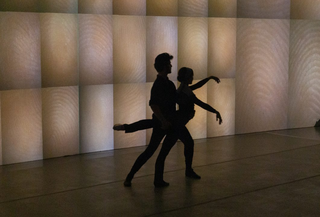 Silhouette of ballet dancers in galleries of Rafael Lozano Hemmer