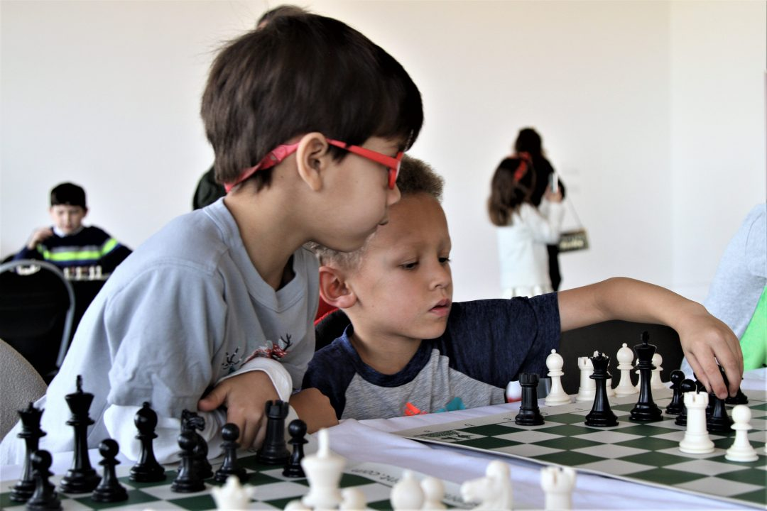 Two children play chess