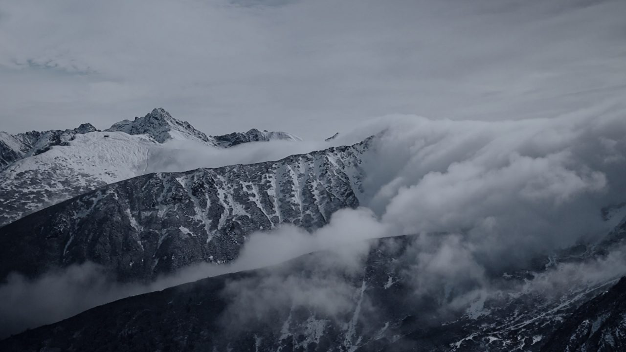 Frame clouds blowing over mountain top from film The Wind: A Documentary Thriller (2019)