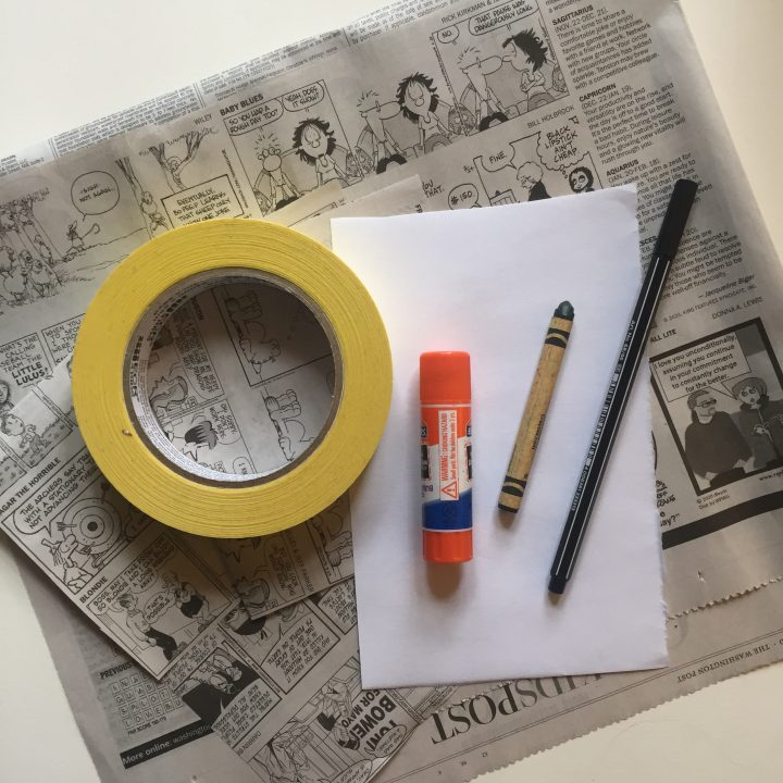 Craft materials. Newspaper, tape, paper, glue, crayon, and pen.