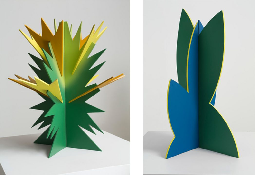 Two abstract sculptures. On the left spikey yellow and green like a cactus, on the right blue and green and shaped like leaves.