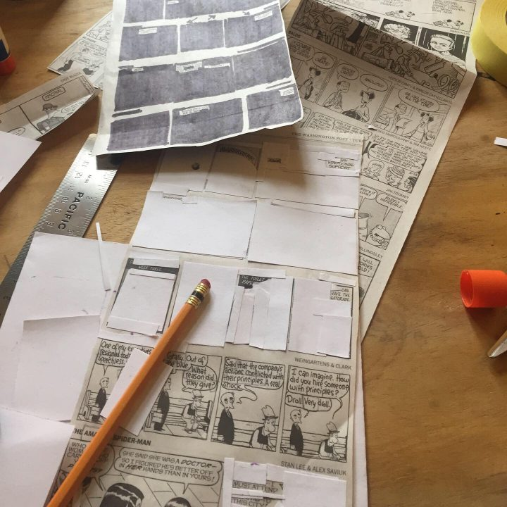 Craft in progress. Newspaper comics with blocks blacked out and paper glued on top.