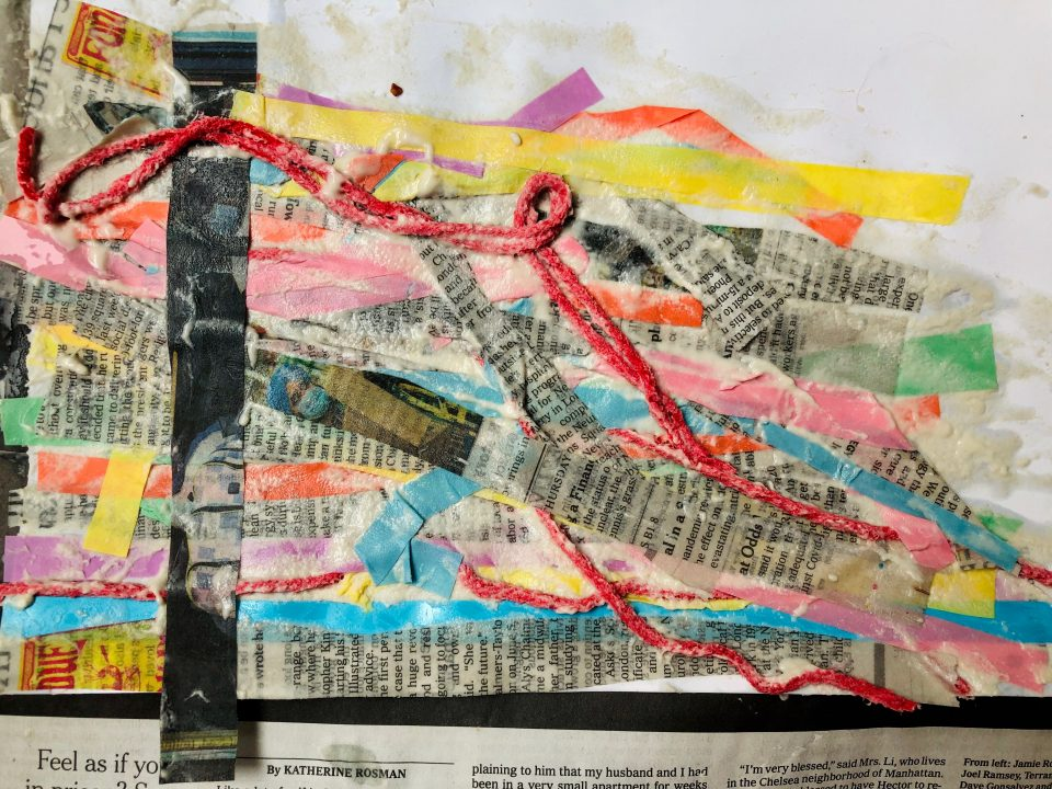 Collage of wet strips of newspaper, colored paper, and red yarn placed diagonally across a canvas with one strip intersecting the rest