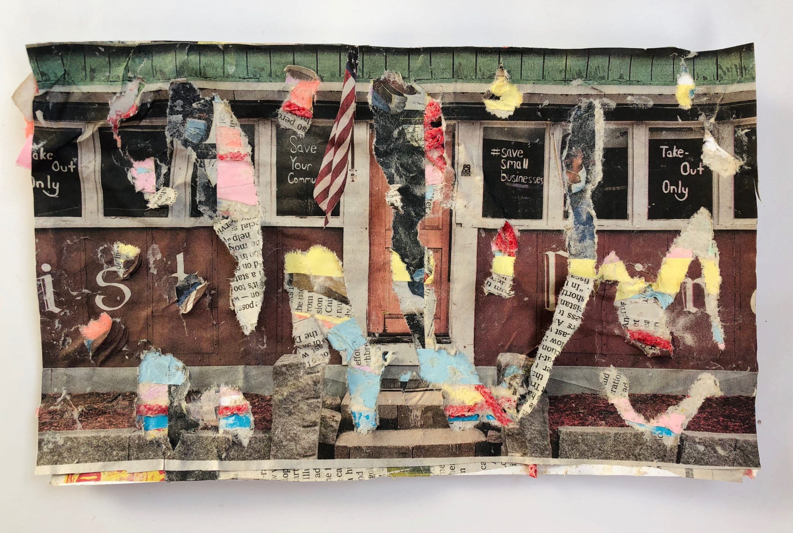 A newspaper clipping of a diner exterior is shredded to reveal other layers of newspaper, multicolored paper, and red yarn underneath