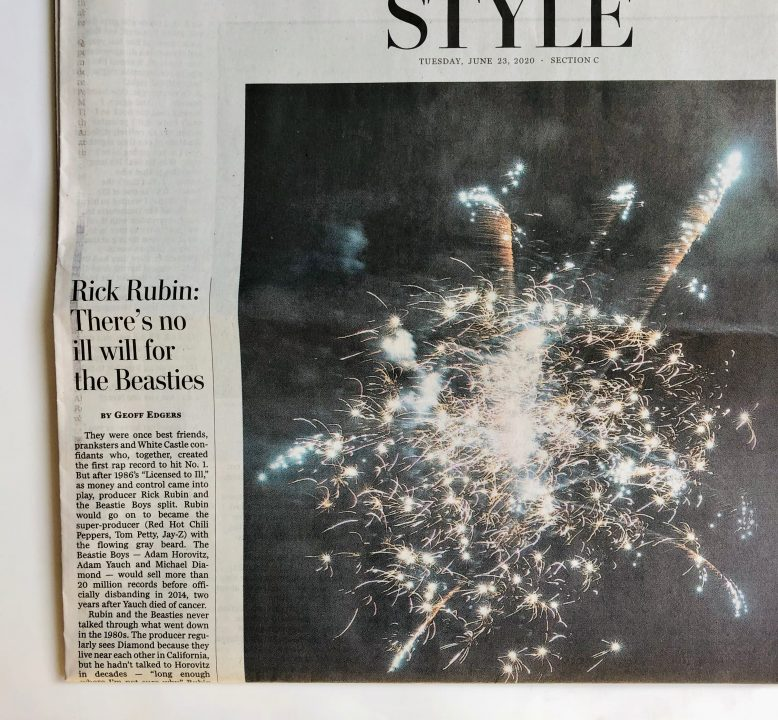 Close-up of a single newspaper page, focused on an image of fireworks