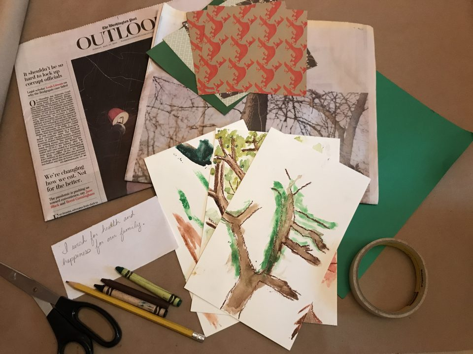 Newspapers, pair of scissors, pencil, crayons, masking tape, green construction paper, cards, and watercolor paintings of trees