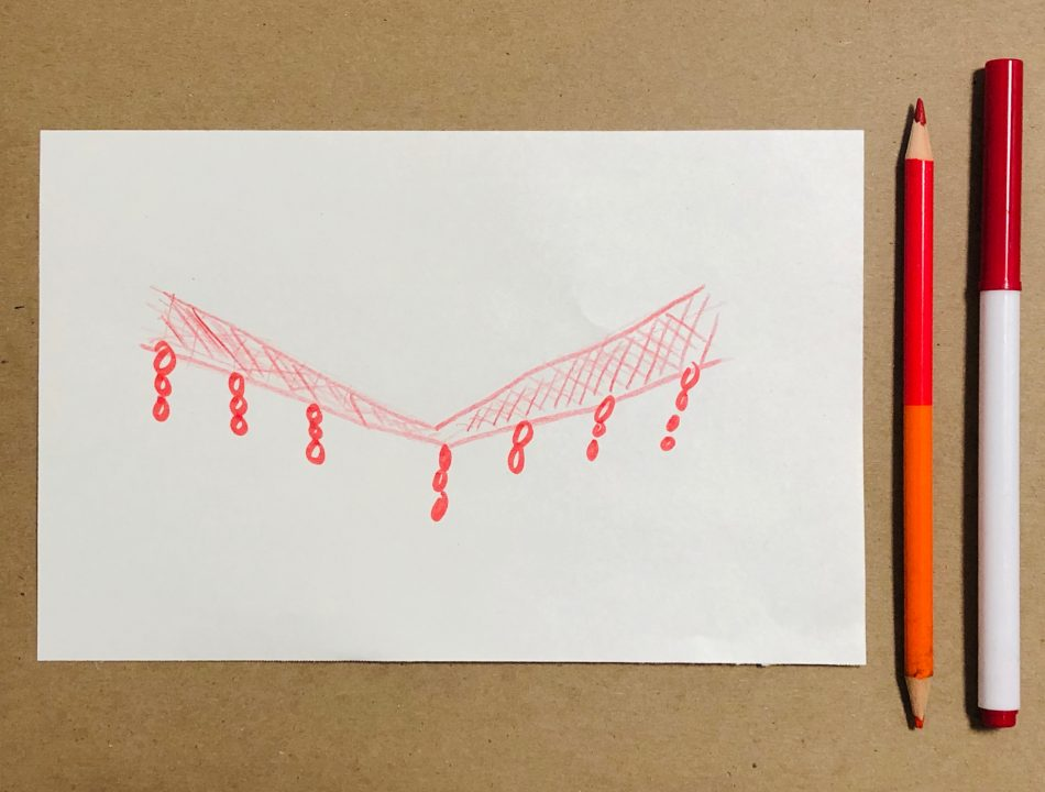 A sketch of a red V-shaped web with looped strings hanging down. A red pencil and red marker rest beside the paper.