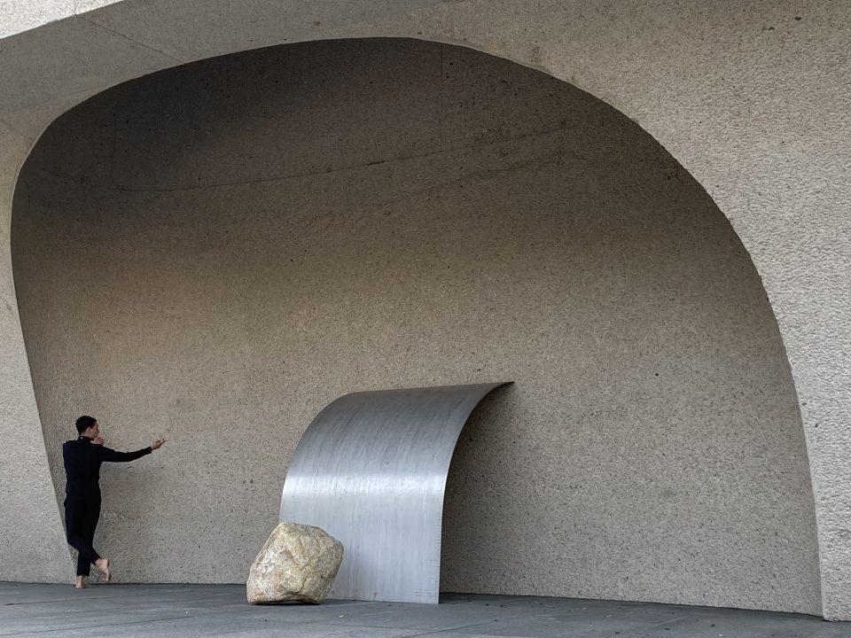 Jonah Bokaer gestures at Lee Ufan's installed work Relatum-Open Corner,