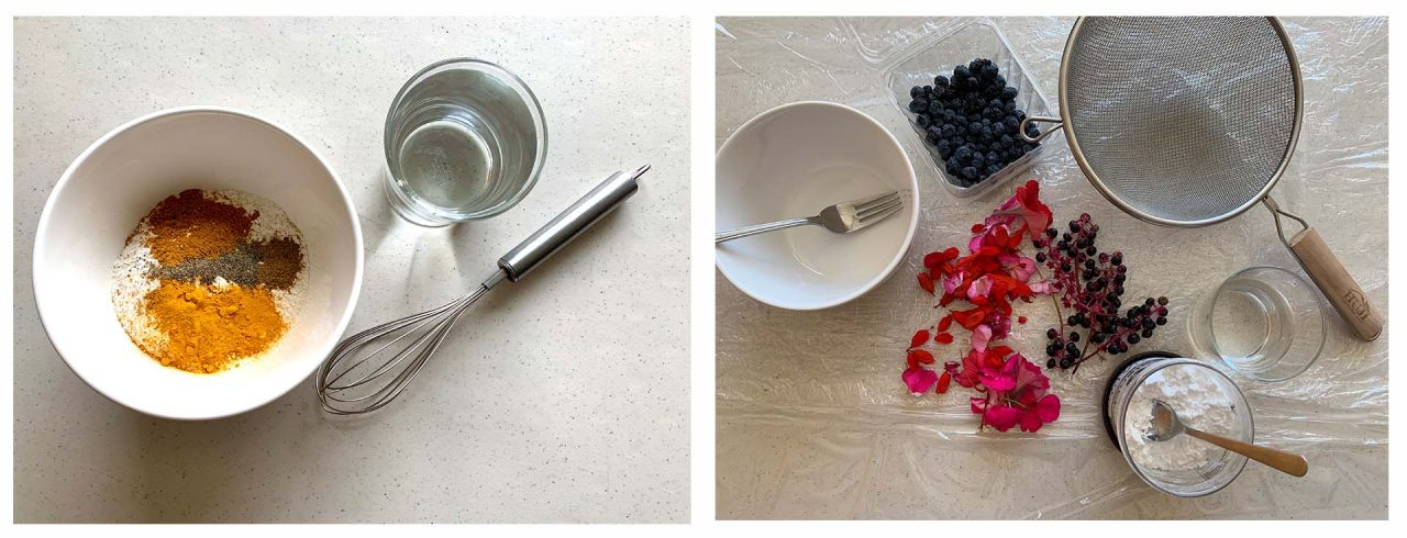 An arrangement of ingredients. On the left, a bowl with the dry mixture is next to a whisk and glass of water. On the right, an arrangement of berries, pokeweed, and a colander.