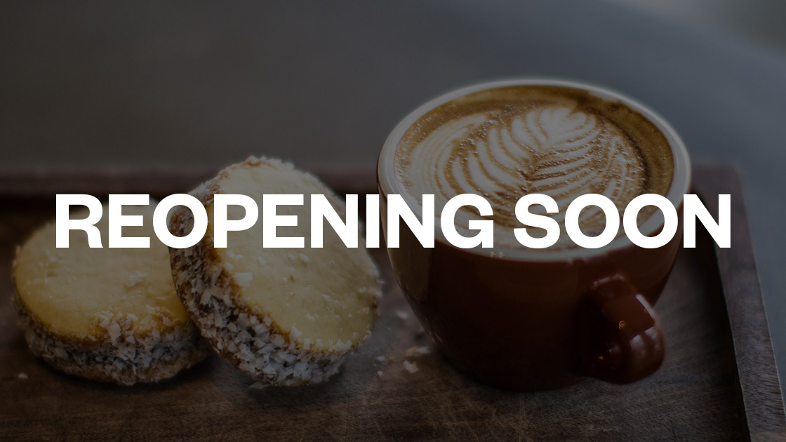 cookie and latte with text reading reopening soon overlaid